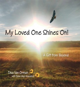 Bright sunrise, a hawk, two sunflowers in a field on the cover of the book My Loved One Shines On! A Gift from Beyond